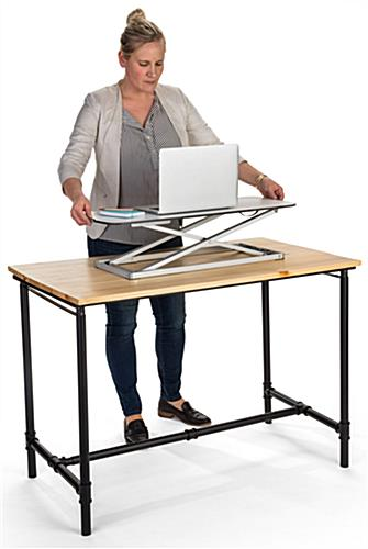 Folding sit stand laptop desk with adjustable height