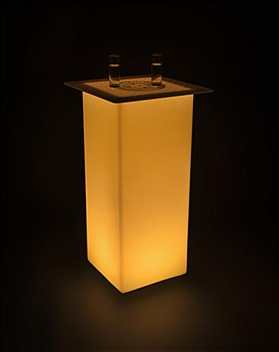Logo LED highboy table with orange lights and full-bleed printed top