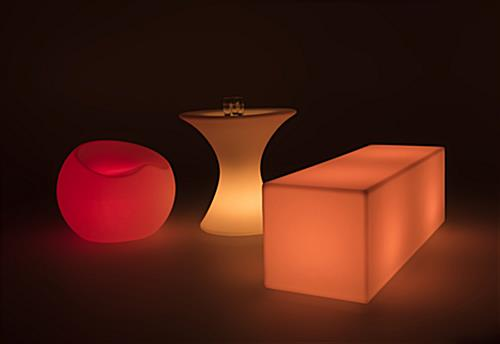 LED cocktail table paired with seating