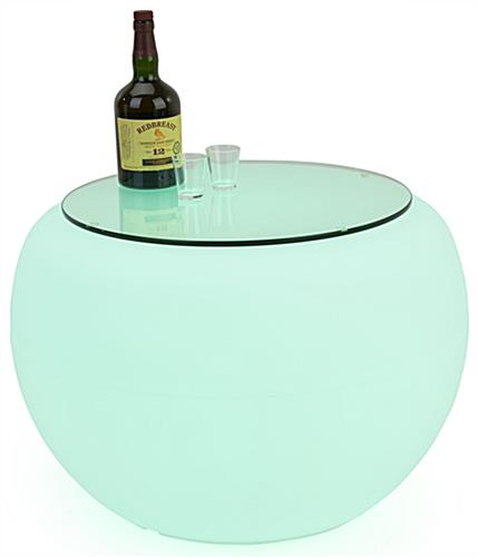 LED round coffee table with teal light and liquor bottle