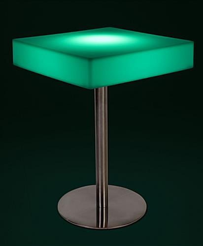 Square glow top bar table with teal illumination