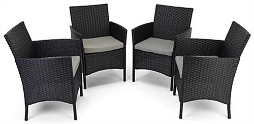 5 Piece rattan outdoor dining set includes four cushioned chairs