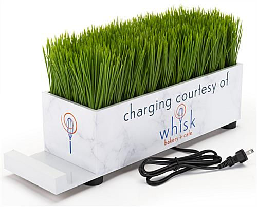 Branded grass charging station with built-in phone holding dock