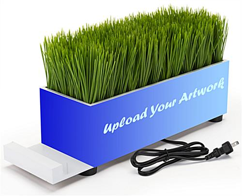 Branded grass charging station with personalized artwork