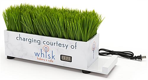 Branded grass charging station with faux green grass