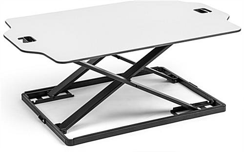 Foldable desktop riser with adjustable height settings