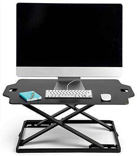 Fold-in standing workstation riser with preset height settings