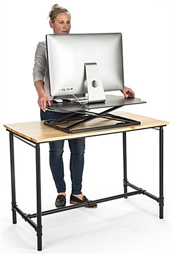 Fold-in standing workstation riser with handles for easy adjustment