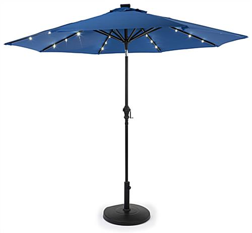 Patio umbrella base supports standard canopies