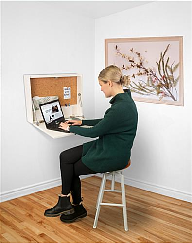 Wall-mounted floating desk with overall dimensions of 24 inches wide by 18 inches tall