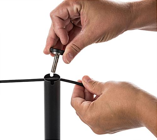 Hand Attaching Rope to Black Exhibit Stanchion
