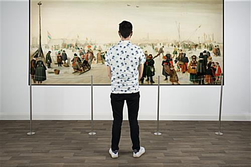 Subtle art gallery fixed floor stanchion crowd control solution