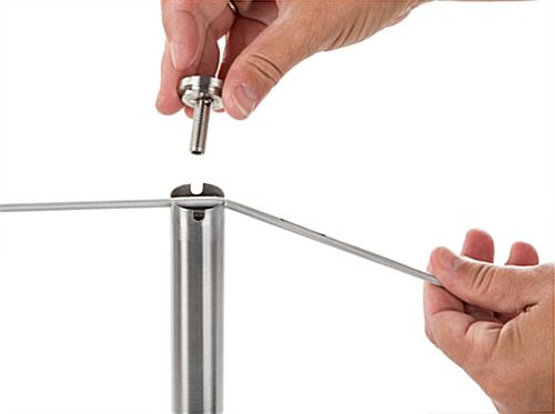 Attaching Rope to Silver Exhibit Stanchion