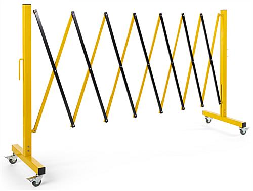 Collapsible security gate with black and yellow finish