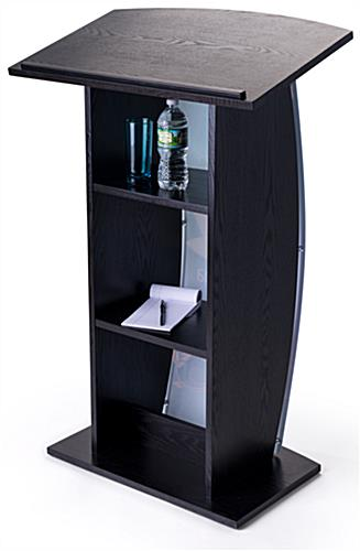 Contemporary curved lectern with custom panel and shelves for presentation essentials
