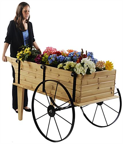 Wooden Flower Cart Being Pushed