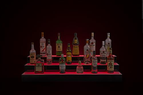 glowing tiered LED liquor shelves