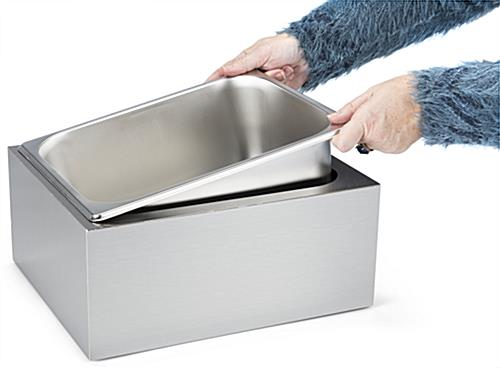 Countertop ice bin with easy to place and remove steel pan