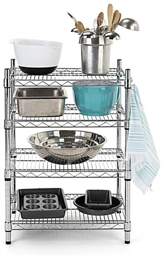 Metal wire shelving unit has four sturdy chrome tiers