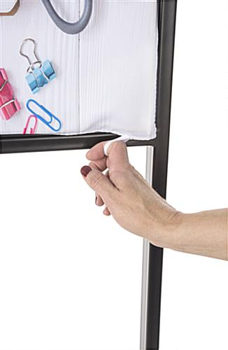 Silicone edge sign display with fabric removal tab on SEG panel