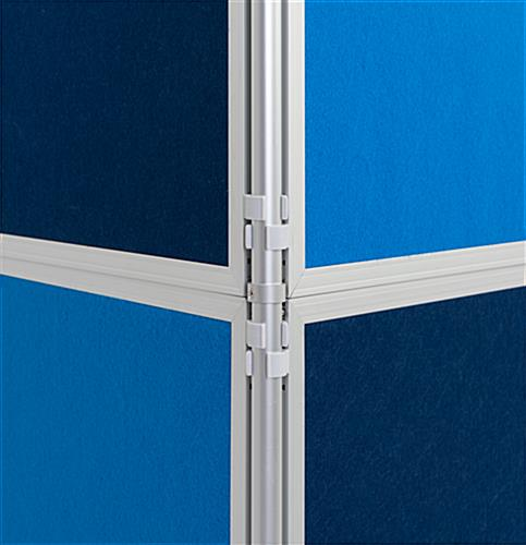 Clip and pole exhibit panel system with dark and light blue panels