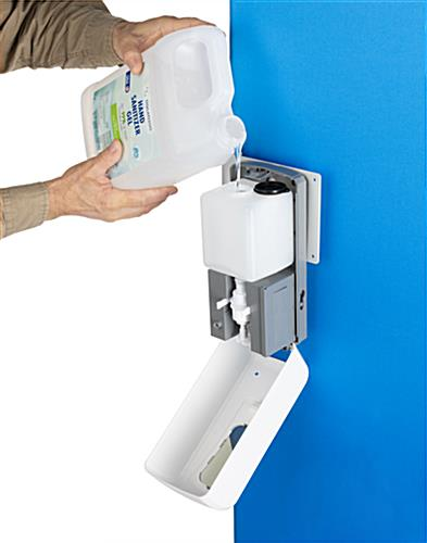 Touch free hand sanitizer with fold down door for easy refill
