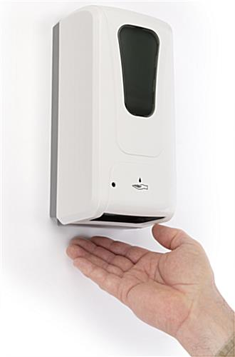 Touch free hand sanitizer dispenser has touchless gel release