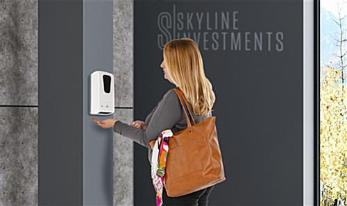 Touch free hand sanitizer with motion sensor release