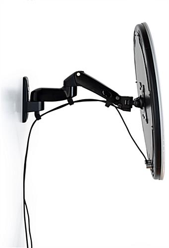 Articulating wall mount photo booth station with multiple adjustment points