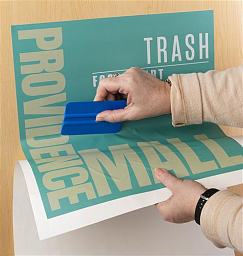 Waste receptacle with custom graphic panel that is easy to apply
