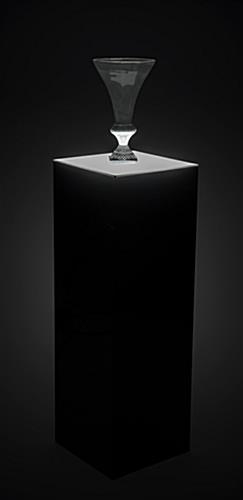 Lighted black riser pedestal for adding glow decoration