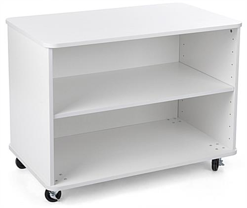 Nesting white wood display shelves for folded clothing
