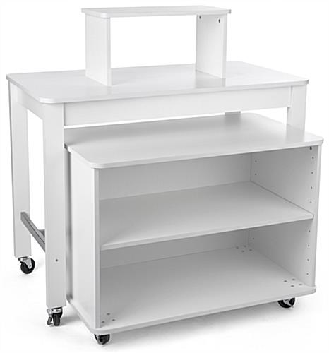 Rolling white tiered table with nesting shelves