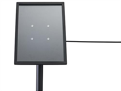 Matte black angled gallery signage plate for stanchions
