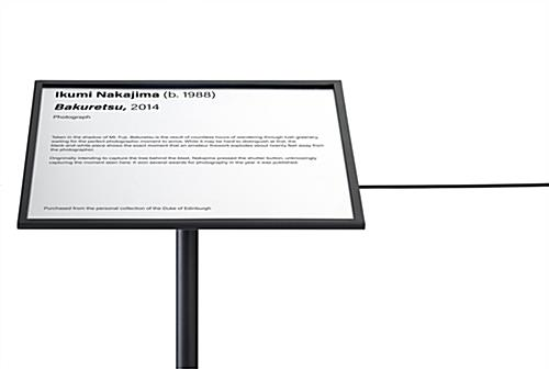 Museum barrier signage frame installed in landscape format