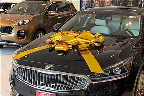 Shiny gold metallic car ribbon bow for dealership showrooms