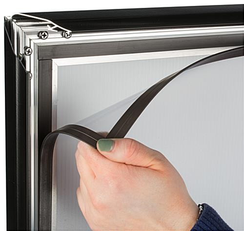 The Outdoor Sign Stand has Magnetic Lining for Attaching an Anti-Glare PVC Lens