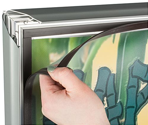 The Spring Loaded Sidewalk Sign has a Magnetic Lined PVC Lens that Keeps Your Sign Safe and Enclosed