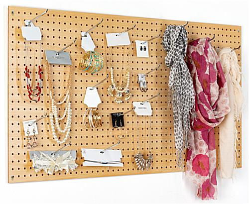 MDF pegboard retail display with natural finish