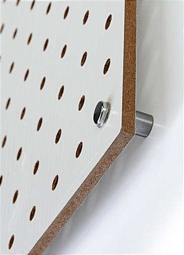 Wall-mounted white pegboard panel