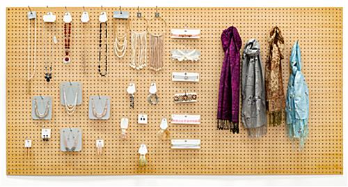 Quick-change retail pegboard wall