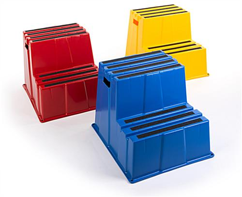 Three Industrial step stands in bright colors