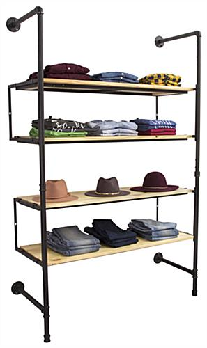 Industrial Pipe Shelving Wall Unit Showcasing Hats and Clothing