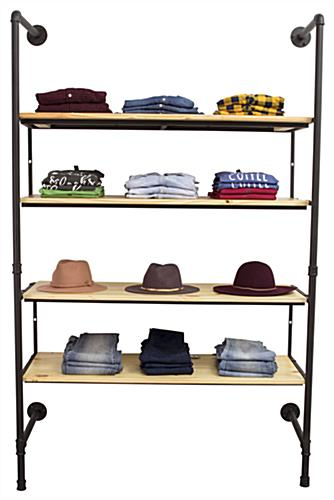 Industrial Pipe Shelving Wall Unit Displaying Folded Clothes