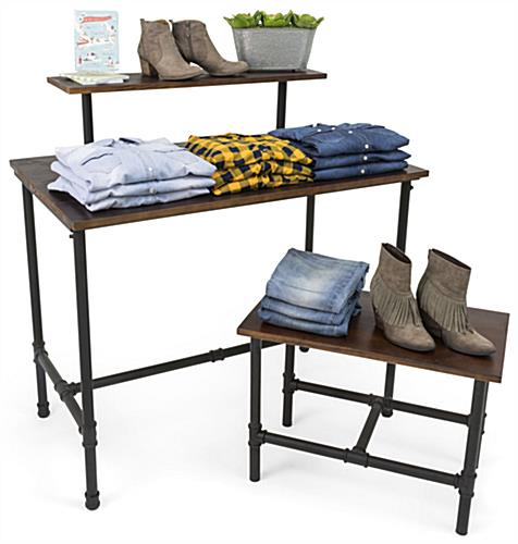 Set of Pipe Display Nesting Tables Showcasing Pants and Shirts
