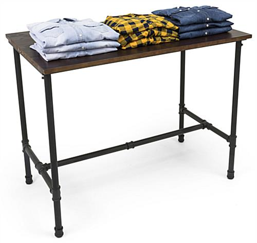 Large Pipe Display Table for Showcasing Folded Clothes