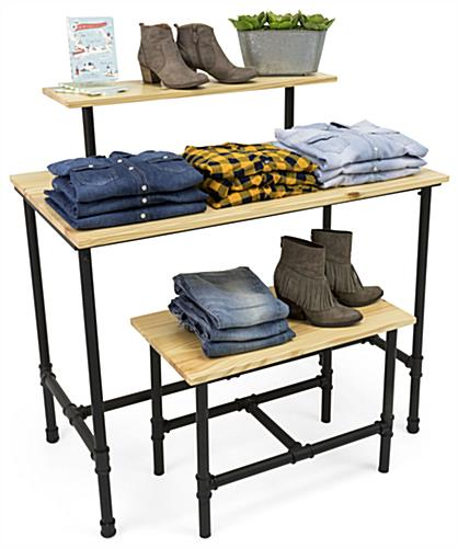 Set of Pipe Retail Nesting Tables Showcasing Clothing