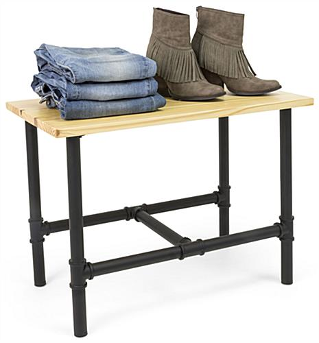 Small Pipe Retail Table Showcasing Folded Jeans