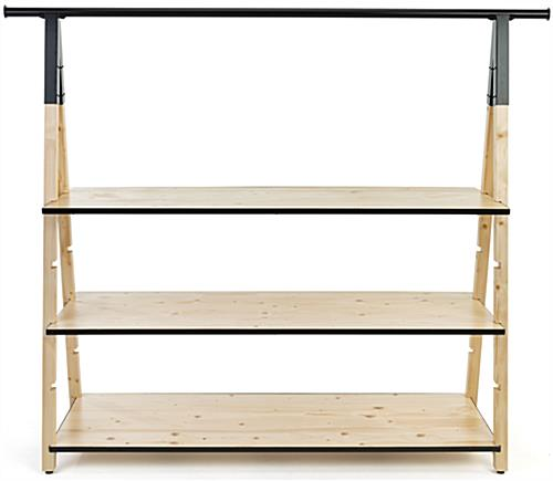 Wooden a frame clothing rack with base shelves and natural pine finish