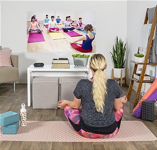 Portable mini projector shows yoga video at home